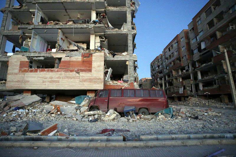 In this photo provided by the Iranian Students News Agency, ISNA, destroyed buildings and a car are seen after an earthquake at the city of Sarpol-e-Zahab in western Iran, Monday, Nov. 13, 2017. A powerful earthquake shook the Iran-Iraq border late Sunday, killing more than one hundred people and injuring some 800 in the mountainous region of Iran alone, state media there said. Photo: AP