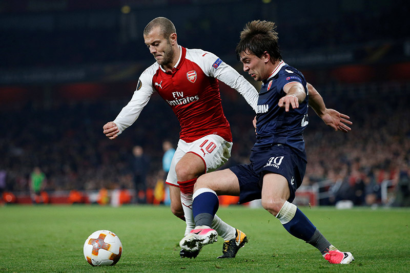 Arsenal's Jack Wilshere in action with Red Star Belgrade's Filip Stojkovic. Photo: Reuters
