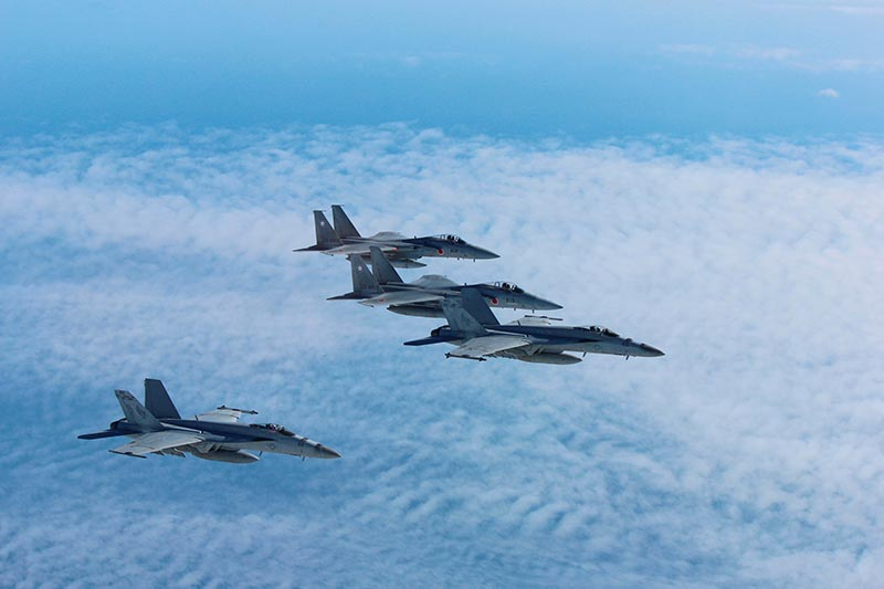 Japan's Self-Defense Force's F-15 fighter jets (top and 2nd from top) conduct an air exercise with US Navy F/A 18 Hornet aircrafts in the skies above the Sea of Japan, Japan, on November 13, 2017. Photo: Air Staff Office of the Defense Ministry of Japan/HANDOUT via Reuters