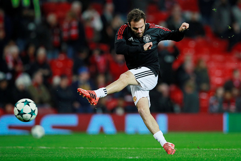 Manchester United's Juan Mata warms up before the match. Photo: Reuters