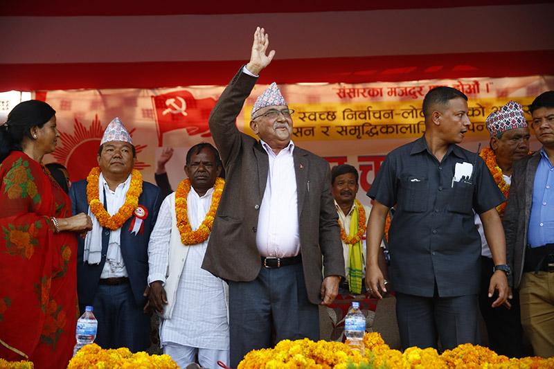 UML Chairman KP Sharma Oli waves hand to supporters after addressing an election rally in Biratnagar, on Sunday, November 19, 2017. Photo: Skanda Gautam