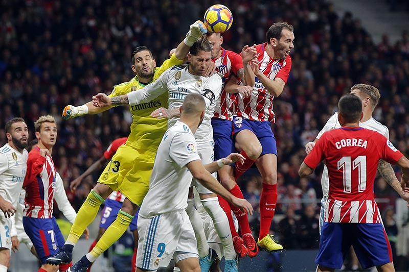 Real Madridu2019s goalkeeper Kiko Casilla (centre left), punches the ball clear during a Spanish La Liga soccer match between Atletico Madrid and Real Madrid at the Metropolitano stadium in Madrid, Spain, on Saturday, November 18, 2017. Photo: AP