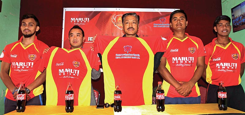 Lalitpur Patriots President Kishore Maharjan (centre) and players unveiling the team jersey during a programme in Kathmandu on Thursday. Photo: THT