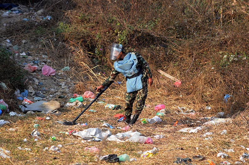A member of Nepali Armyu2019s bomb disposal squad combing the area after an explosion near the venue of election rally addressed by CPN-UML Chair KP Sharma Oli, in Lalitpur, on Tuesday, November 28, 2017. Photo: Balkrishna Thapa Chhetri/THT
