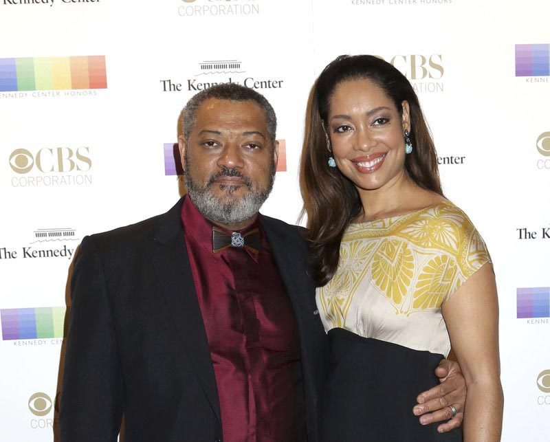 Laurence Fishburne (left), and Gina Torres attend the 38th Annual Kennedy Center Honors at The Kennedy Center Hall of States in Washington, on  December 6, 2015. Photo: AP/ File