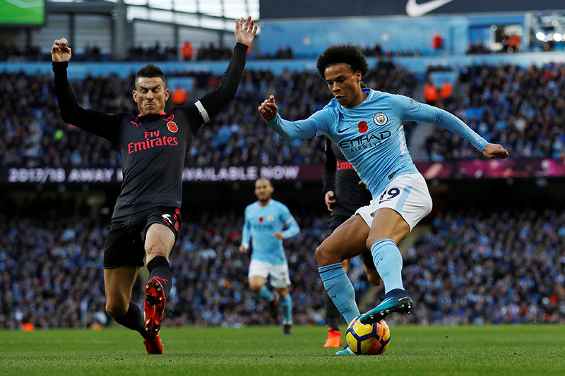Manchester City's Leroy Sane in action with Arsenal's Laurent Koscielny. Photo: Reuters