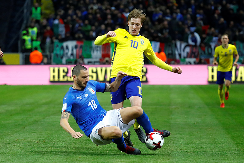 Italyu2019s Leonardo Bonucci in action with Swedenu2019s Emil Forsberg. Photo: Reuters