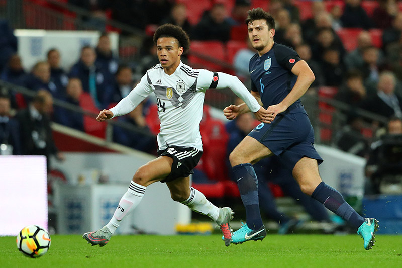 Germanyu2019s Leroy Sane in action with Englandu2019s Harry Maguire. Photo: Reuters