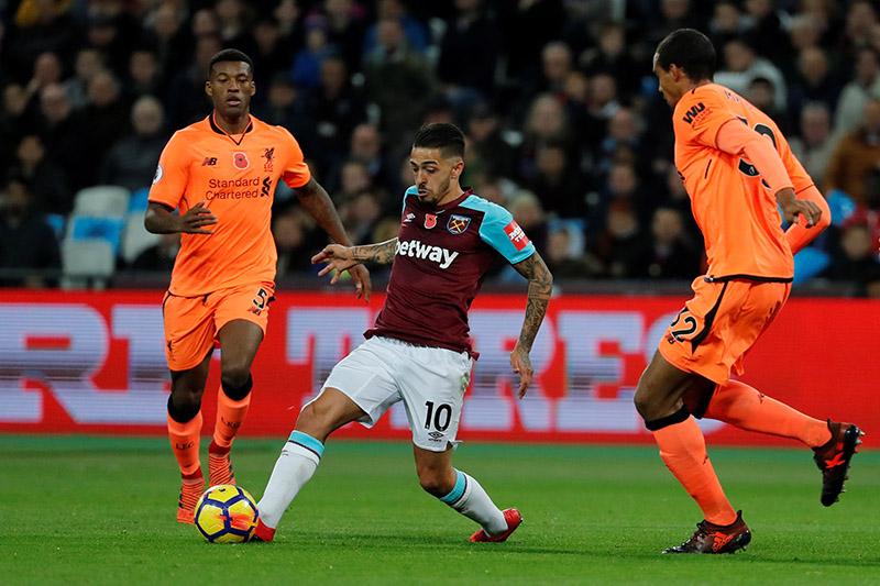 West Ham United's Manuel Lanzini in action with Liverpool's Georginio Wijnaldum and Joel Matip (R). Photo: Reuters