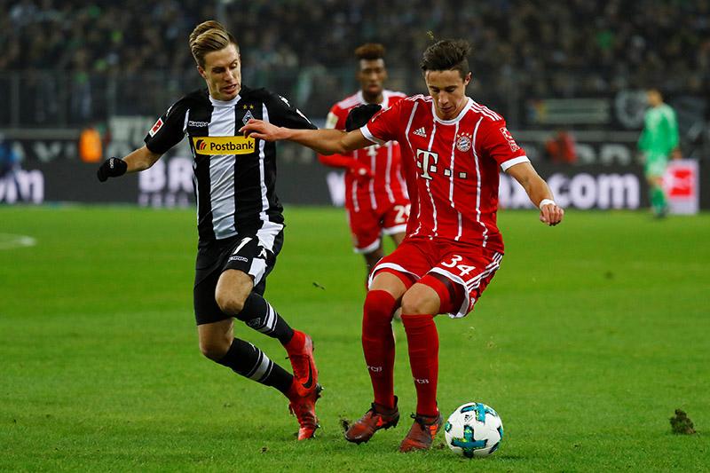 Bayern Munich's Marco Friedl in action with Borussia Monchengladbachu2019s Patrick Herrmann. Photo: Reuters