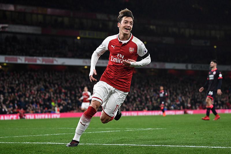 Arsenal's Mesut Ozil celebrates scoring their fourth goal. Photo: Reuters