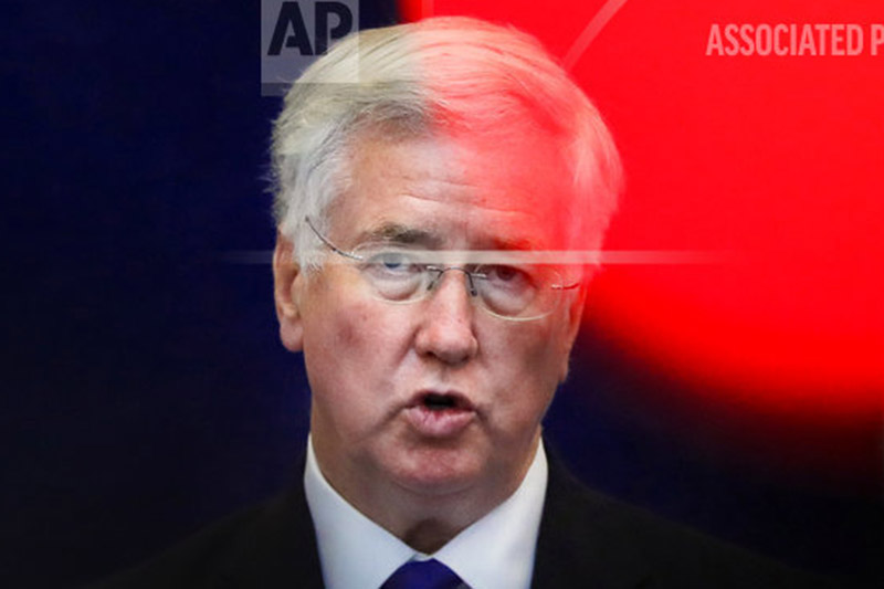 FILE - In this file photo dated Thursday, June 15, 2017, Britain's defense minister Michael Fallon speaks at the Romanian defense ministry in Bucharest, Romania. Photo: AP