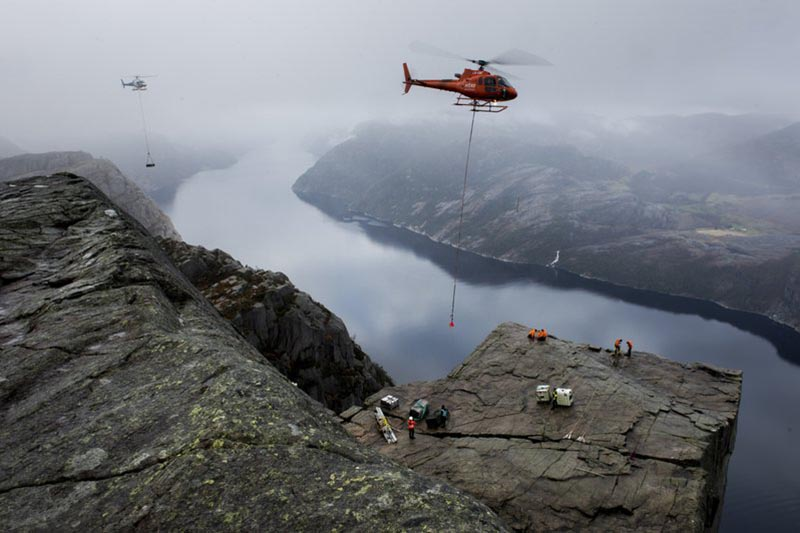 Equipment in preparation for filming of a new Mission Impossible movie is airlifted by helicopters to Preikestolen (Pulpit Rock) in Lysefjorden near Stavanger, Norway, on Friday November 3, 2017. Photo: AP