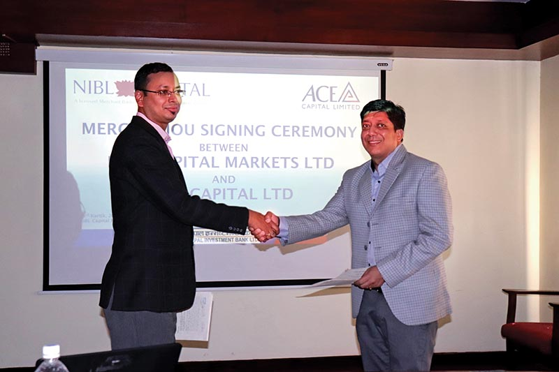 Sachin Tibrewal, chairman of NIBL Capital and Rabin Sijapati, chairman of Ace Capital, exchanging the MoU, in Kathmandu, on Thursday. Photo: THT