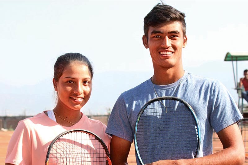 Western Regionu2019s Abhishek Bastola and Nepal Police Clubu2019s Mayanka Rana celebrate after winning the singles titles of the 14th National Lawn Tennis Tournament in Lalitpur on Tuesday. Photo: THT