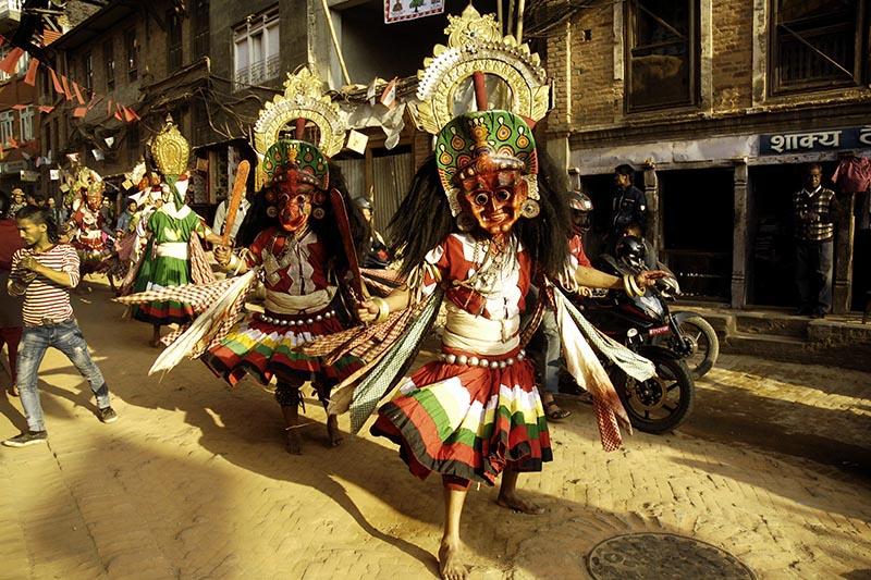 Masked men performing  Navadurga Bhawani Naach, in Bhaktapur, on Friday, November 24, 2017.  on Friday. Photo: Naresh Shrestha