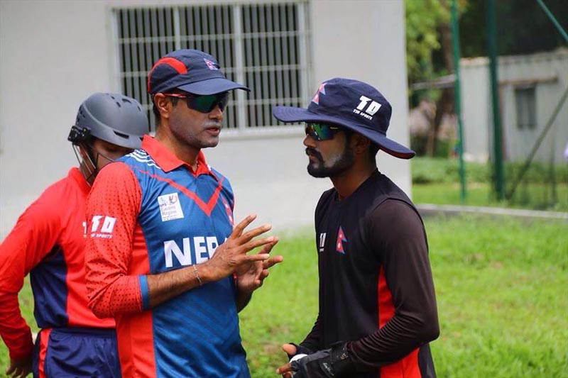 Nepal U-19 cricket team head coach Binod Das (left) chats with skipper Dipendra Singh Airee, on Sunday, November 12, 2017. Photo courtesy: NSJF