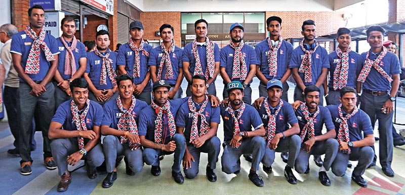 Nepal U-19 cricket team members pose for a group photo at the Tribhuvan International Airport in Kathmandu on Saturday. Photo: THT