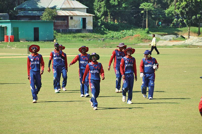 Nepal U-19 cricket team players walk off the pitch after fielding against Bangladeshi youth side during their third and final friendly match at the Bangladesh Krira Shikkha Prothisthan Ground in Dhaka on Sunday. Photo Courtesy: Raman Shiwakoti