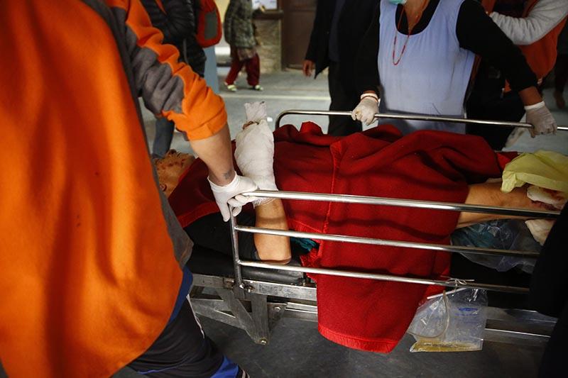 Nepali Congress Udayapur-2 parliamentary poll candidate Narayan Karki being carried on a stretcher after sustaining injuries in a blast in Udayapur, at TU Teaching Hospital, in Kathmandu, on Wednesday, November 29, 2017. Photo: Skanda Gautam/THT