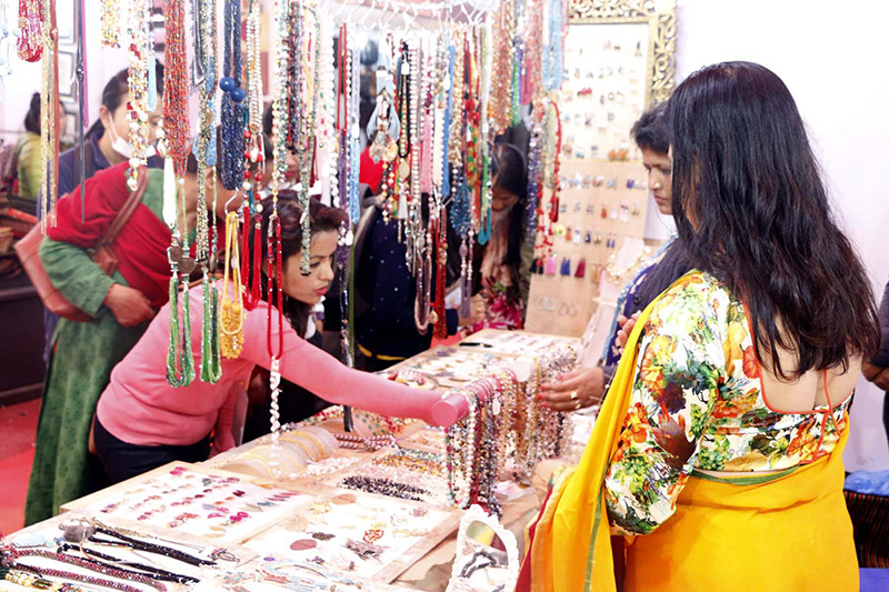 People visit a stall during the 15th Handicraft Expo organised by the Federation of Handicraft Association of Nepal at Bhrikutimandap, in Kathmandu, on Friday, November 17, 2017. Photo: RSS