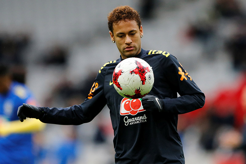 Brazil's Neymar warms up before the match. Photo: Reuters