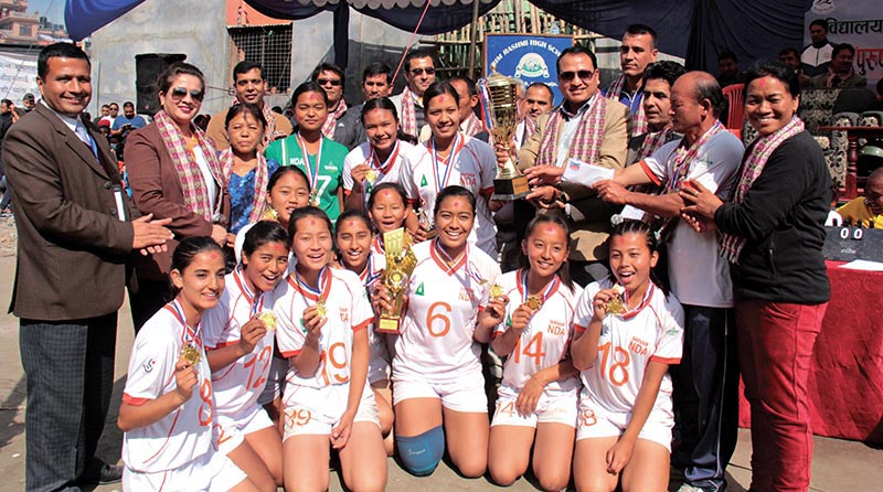 New Diamond Academy team members celebrate with other officials after winning the first PABSON U-18 National Volleyball Tournament in Kathmandu on Sunday. Photo: THT