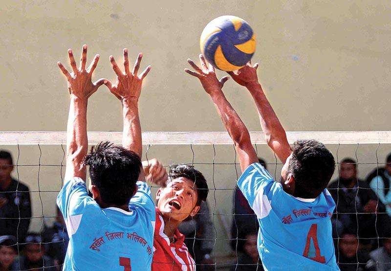 A player of Newton School jumps for a spike against Surkhet Volleyball Association during their first PABSON U-18 National VolleyballTournament match in Kathmandu on Thursday. Photo: THT