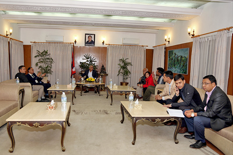 A team led by Dr. Govinda KC holding discussion on certification of ordinance on Medical Education Bill with PM Sher Bahadur Deuba, at latter's residence at Baluwater, Kathmandu, on Thursday, November 09, 2017. Photo: RSS