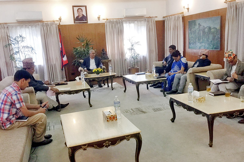 PM Sher Bahadur Deuba holding meeting with the Election Commissions at latters official residence at Baluwater, Kathmandu, on Friday, November 03, 2017. Photo: RSS