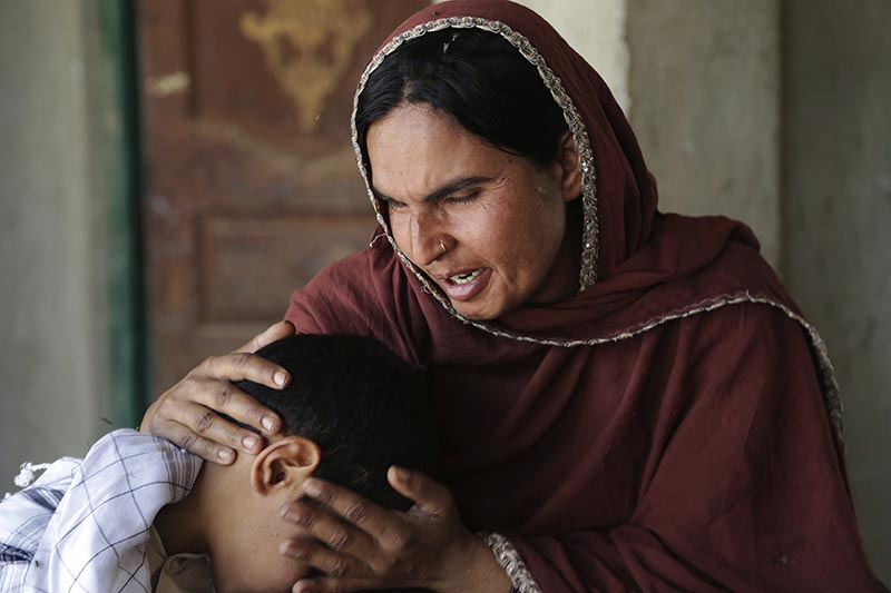 Kausar Parveen comforts her child who was allegedly raped by a mullah or religious cleric, in Kehror Pakka, Pakistan, on  May 4, 2017. Photo: AP