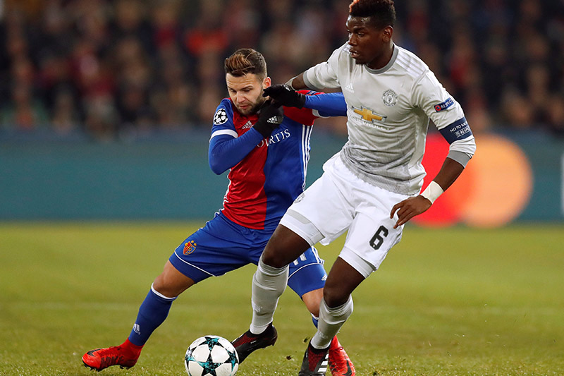 Manchester United's Paul Pogba in action with Baselu2019s Renato Steffen. Photo: Reuters