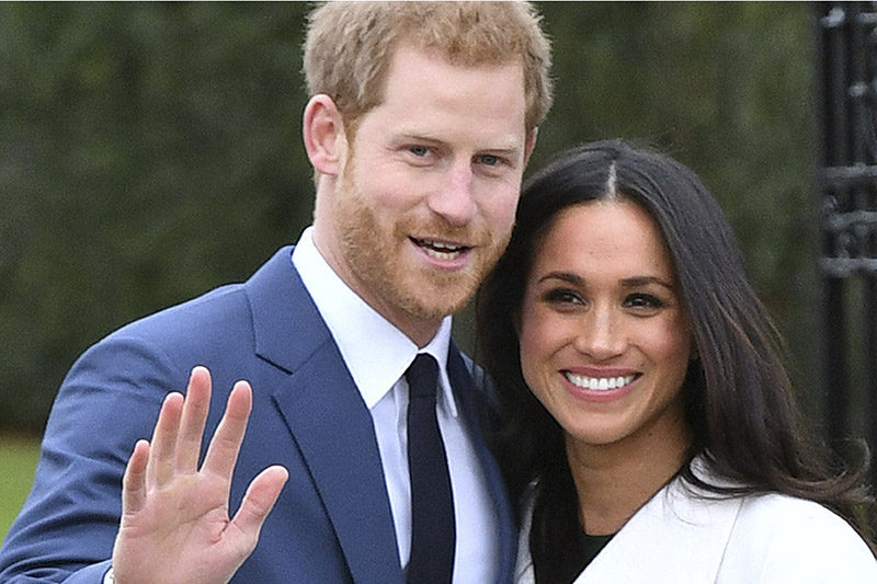 Britain's Prince Harry and Meghan Markle  pose for the media in the grounds of Kensington Palace in London, Monday Nov. 27, 2017. Photo: AP