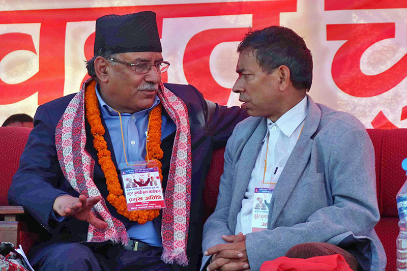 CPN-Maoist Centre Pushpa Kamal Dahal and UML leader Devi Gywali talk during a programme organised by the leftist alliance after filing nomination for upcoming polls in Chitwan district, on Thursday, November 02, 2017. Photo: Tilak Ram Rimal