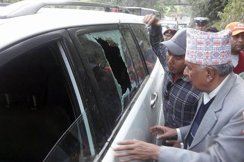 Nepali Congress senior leader Ram Chandra Paudel looks at the broken glass of his vehicle in Lamjung. A pressure cooker bomb exploded targeting leader Paudel in the district, on Saturday, November 18, 2017. Photo: NC Secretariat