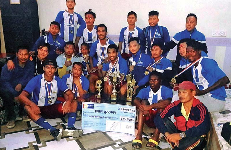 Players and officials of CMG Club Sankata pose for a group photo after winning the Rhino Gold Cup in Nawalparasi on Thursday. Photo: THT