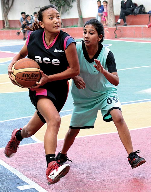 Players of Ace and Nepal Mega College (right) in action during the second Rosebud Inter-school Basketball Tournament in Kathmandu on Saturday. Photo: THT