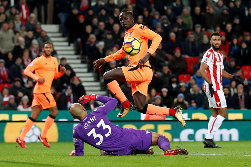 Liverpool's Sadio Mane scores their first goal. Photo: Reuters