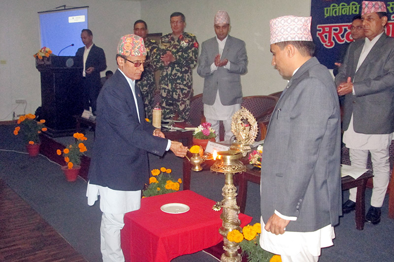 Election Commission Ishwori Prasad Paudel lits up a candle before Security Meeting for upcoming polls kicks off in Pokhara, on Friday, November 10, 2017. Photo: Rishi Ram Baral