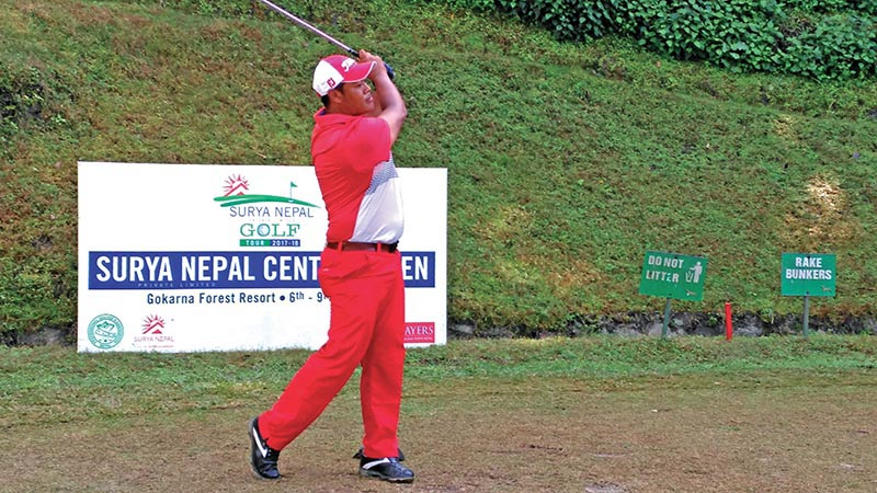 Nepal No 1 pro Shivaram Shrestha watches the ball after hitting a tee shot on the 10th hole during the second round of the Surya Nepal Central Open at the Gokarna Golf Club in Kathmandu on Tuesday. Photo Courtesy: NPGA