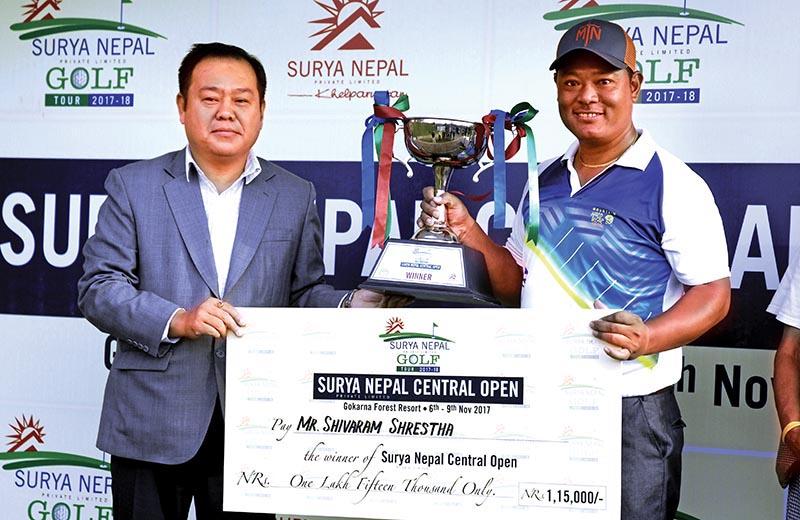 Marketing Manager of Surya Nepal Pvt Ltd Bal Kishan Gurung handing over winneru2019s trophy to Nepal No 1 pro Shivaram Shrestha (right) after the Surya Nepal Central Open at the Gokarna Golf Club in Kathmandu on Thursday. Photo: Naresh Shrestha / THT