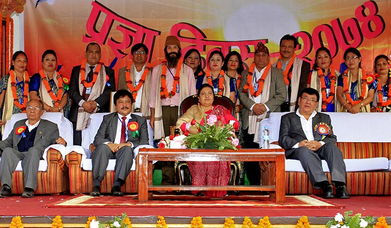 President Bidhya Devi Bhandari (centre), Sanduk Ruit (right) along with the teachers and staff of Siddhartha Vanasthali Institute, posing for a picture during the Academic Day programme at the Siddhartha Vanasthali Institute in Balaju, Kathmandu, on Saturday, November 4, 2017. Photo: RSS