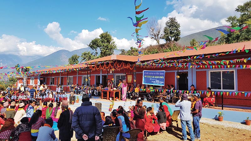 This file photo shows a function organised to hand over a new building to Ganesh Lower Secondary School, in Sindhupalchowk. Photo: THT