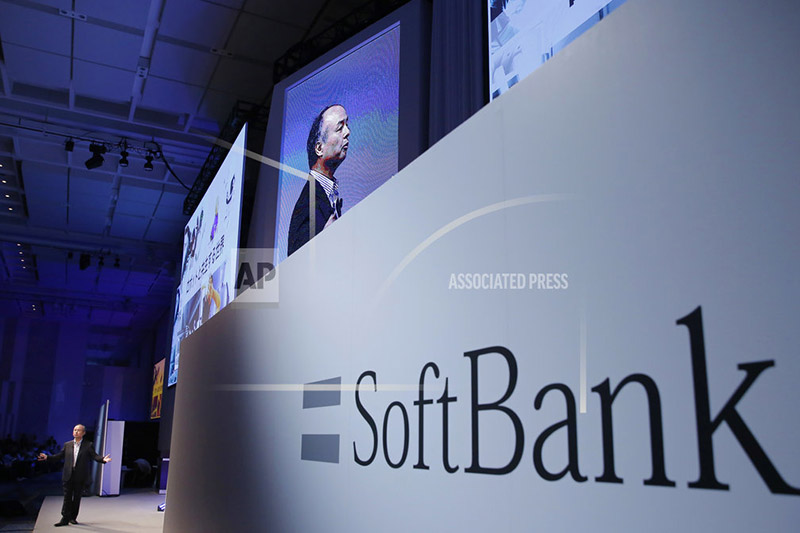 FILE - In this July 20, 2017, file photo, SoftBank Group Corp. Chief Executive Officer Masayoshi Son, left, speaks during a SoftBank World presentation at a hotel in Tokyo. Photo: AP
