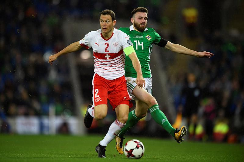 Northern Irelandu2019s Stuart Dallas in action with Switzerlandu2019s Stephan Lichtsteiner. Photo: Reuters