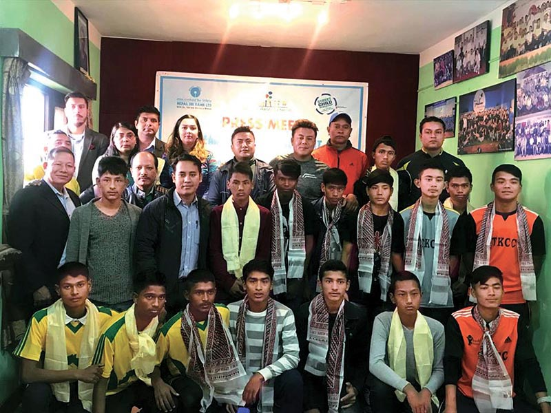 Team members of the Street Child World Cup pose for a group photo with officials during a press meet in Kathmandu on Sunday. Photo: THT