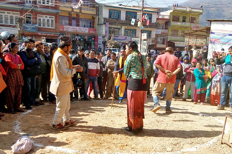Artists performing street drama for creating public awareness about the upcoming elections, in Bidur, Nuwakot district headquartes, on Monday, November 20, 2017. Photo: RSS