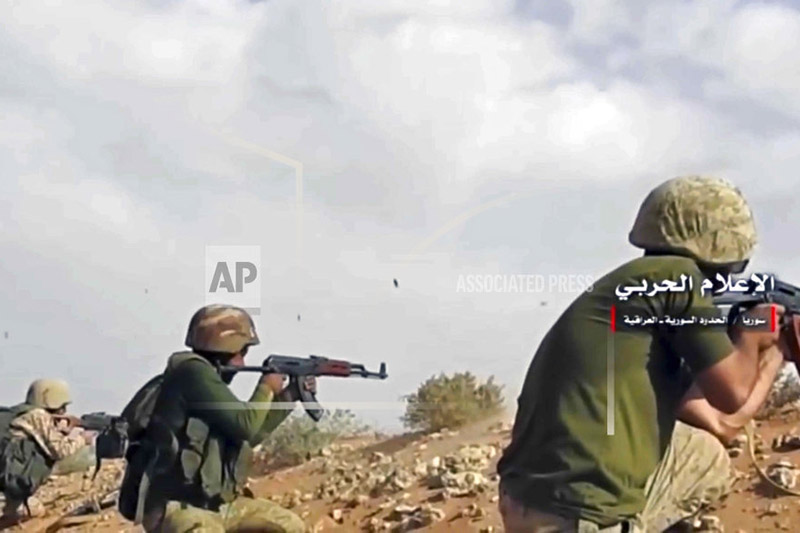 This frame grab from video provided Wednesday, Nov 8, 2017 by the government-controlled Syrian Central Military Media, shows Syrian pro-government troops taking up positions and firing on militants' positions on the Iraq-Syria border. Photo: AP