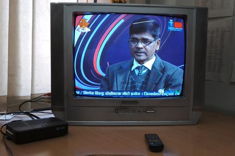 A television set with digital system of cable TV broadcasting connected to a set-top box (left), on Saturday, November 18, 2017. Photo: THT Online