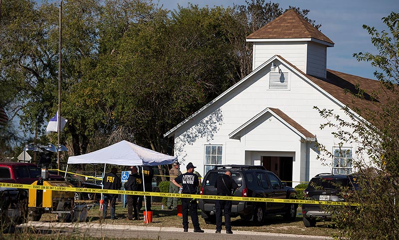 Law enforcement officials investigate a mass shooting at the First Baptist Church in Sutherland Springs, Texas, US, on November 5, 2017. Photo: Nick Wagner/AMERICAN-STATESMAN via Reuters